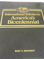 56 FDC TRIBUTE TO AMERICA'S 1976 BICENTENNIAL INTERNATIONAL STAMPS COVERS ALBUM