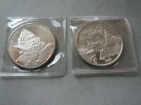 LOT OF 2 CHRISTMAS 1 OZ .999 DATED  SILVER ROUNDS  MERRY CHRISTMAS SANTA SNOWMAN