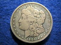 1904 MORGAN SILVER DOLLAR  - LY TONED ABOUT FINE WITH A LITTLE COLOR