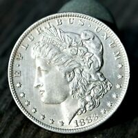 100 GENUINE NEW ORLEANS 1883 O ''MORGAN SILVER DOLLAR' COIN..LIGHTLY CIRCULATED