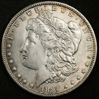 1892-O MORGAN SILVER DOLLAR.  NATURAL UNCLEANED. CHEST FEATHERS. AU-UNC.  159466