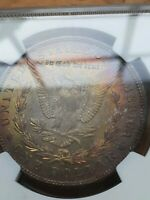 1904 O MORGAN SILVER DOLLAR MONSTER RAINBOW TONED BOTH SIDES. NGC MINT STATE 64