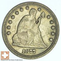 1877 SEATED LIBERTY SILVER QUARTER XB70