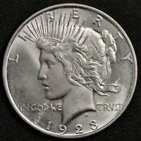 1923-D PEACE SILVER DOLLAR. ERROR STRUCK OVER OBV. DOUBLE PROFILE BACK BU 124755