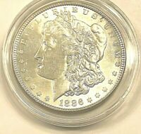 1886 MORGAN SILVER DOLLAR BU BRIGHT CARTWHEEL FINISH IN NEW COIN HOLDER