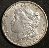 1894-O MORGAN SILVER DOLLAR.  NATURAL UNCLEANED. CHEST FEATHERS.  AU-UNC  159469