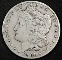 1904-S MORGAN SILVER DOLLAR.  NATURAL UNCLEANED.  F-VF.  160995