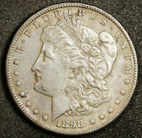 1898-S MORGAN SILVER DOLLAR.  NATURAL UNCLEANED.  AU.  164479