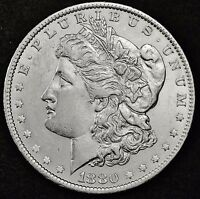 1880-O MORGAN SILVER DOLLAR.  FULL CHEST FEATHERS.  HIGH GRADE.  INVENTORY G