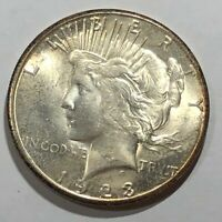 1923-S BU PEACE SILVER DOLLAR. ORIGINAL LIGHT TONED, WEAK STRIKE.