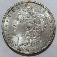 1879 AU MORGAN SILVER DOLLAR. LOT1 HAIRLINED FROM HARSH CLEANING
