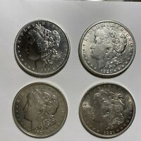 HERE ARE FOUR MORGAN SILVER DOLLARS ONE BEING A LOT OF 4 1900 1921 1921S 1921