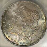 1882-P MORGAN SILVER $1 ICG MINT STATE 65 TONED WITH A HINT OF RAINBOW COLORS