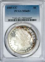 1885-CC MORGAN PCGS MINT STATE 65 SILVER DOLLAR GEM WITH COLORFUL CRESCENT TONING