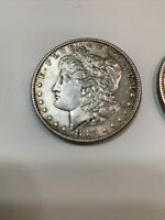 2 ONE DOLLAR MORGAN COINS DATED 1885 AND 1886