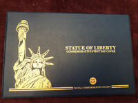 STATUE OF LIBERTY COMMEMORATIVE FIRST DAY COVER WITH 1986 HALF DOLLAR AND STAMPS