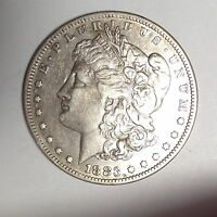 1883 S MORGAN SILVER DOLLAR.