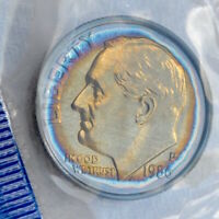 1986 ROOSEVELT DIME TONED IN US MINT CELLOPHANE UNCIRCULATED