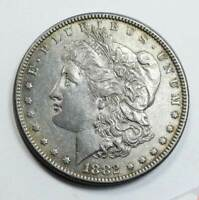 1882 MORGAN SILVER DOLLAR. ALMOST UNC
