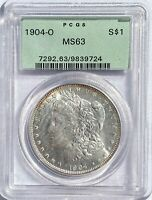 1904 O MORGAN SILVER DOLLAR    PCGS MINT STATE 63 LIGHTLY TONED RIM AND REVERSE GREAT