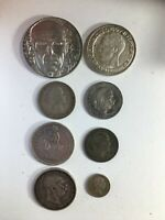 EIGHT SILVER WORLD COINS OF ALL DENOMONATIONS