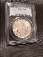 1882 CC MORGAN DOLLAR PCGS MINT STATE 64. WHITE NO SPOTS OR TONING. READ