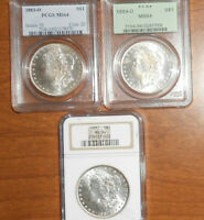 3 ENCASED MORGAN SILVER DOLLARS:1883-O & 1884-O BOTH PCGS MINT STATE 64 & 1887 NGC MINT STATE 64