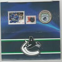 2014 VANCOUVER CANUCKS 25 CENT COIN STAMPS CARDED