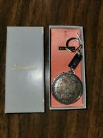 1882-P MORGAN TONED SILVER DOLLAR. SIMMONS JEWELRY STERLING SILVER.