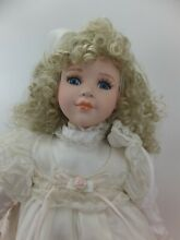 bisque doll porcelain doll in cream dress