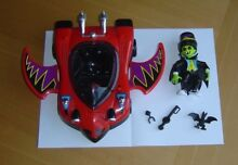 little dracula figure and red