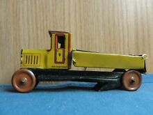 penny toy fischer tin litho dump truck driver