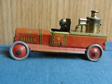 penny toy fischer tin litho fire truck driver