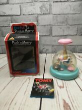 merry go round tomy push n baby carousel toy fully