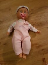 soft bodied doll dressed in