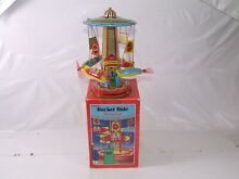 carousel schylling tin plate wind up rocket