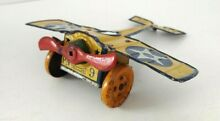 nonpareil tin lithographed wind up airplane