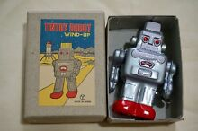y tin toy new 3 1 wind up silver