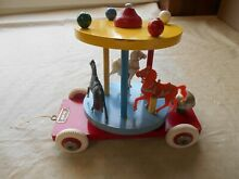brio wooden pull toy carousel w 3