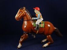 tin toy wind up derby mechanical
