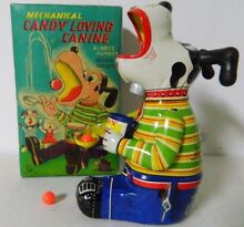 mechanical tin toy candy loving