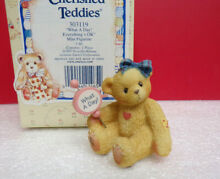 cherished teddies miniature what a day girl holding