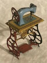 penny toy german tin sewing machine