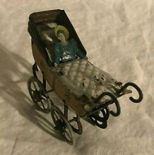 german tin penny toy baby in buggy