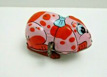 yone wind up toy pink dog toys tin toy