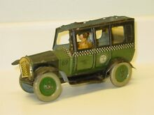tin litho chek a cab wind up toy