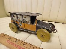 mohawk 1910s checker taxi tin toy wind up