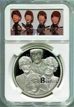 beatles 40mm silver coin in a remco doll