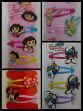 Girls hair clips / ties,4 pk, smurfs, dora, princesses, tinkerbell, minnie mouse