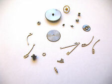 IWC,INTERNATIONAL 87  ASSORTED NEW OLD STOCK MOVEMENT PARTS